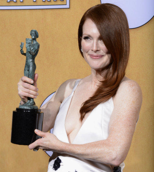 "It took Julianne Moore 10 tries (and one wicked impersonation of Sarah Palin in HBO's ""Game Change"") to finally bring home a SAG Award. Just for the record, here's what Moore didn't win for [take a deep breath]: ""The Kids Are All Right"" (cast), ""Far From Heaven"" (lead actress), ""The Hours"" (cast and supporting actress), ""Magnolia"" (cast and supporting actress), ""The End of the Affair"" (lead actress), and ""Boogie Nights"" (cast and supporting actress). Whew! <br><br> --<i><a href=""http://www.twitter.com/geoffberkshire"">Geoff Berkshire</a>, <a href=""http://www.zap2it.com"">Zap2it</a></i>"
