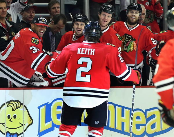 Blackhawks defenseman Duncan Keith celebrates with teammates after scoring against the Detroit Red Wings on Sunday to help the Hawks get to 6-0-0.