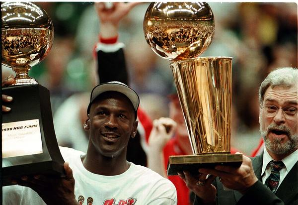 Michael Jordan (left) and Phil Jackson celebrated six Bulls titles before they were done.