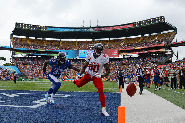AFC wide receiver Andre Johnson misses a catch while defended by Charles Tillman in the first quarter at Aloha Stadium.