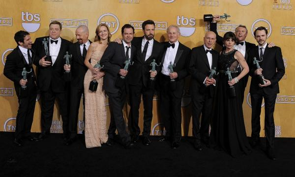 "The cast of ""Argo"" poses backstage with the award for performance by a cast in a motion picture at the 19th Screen Actors Guild Awards."