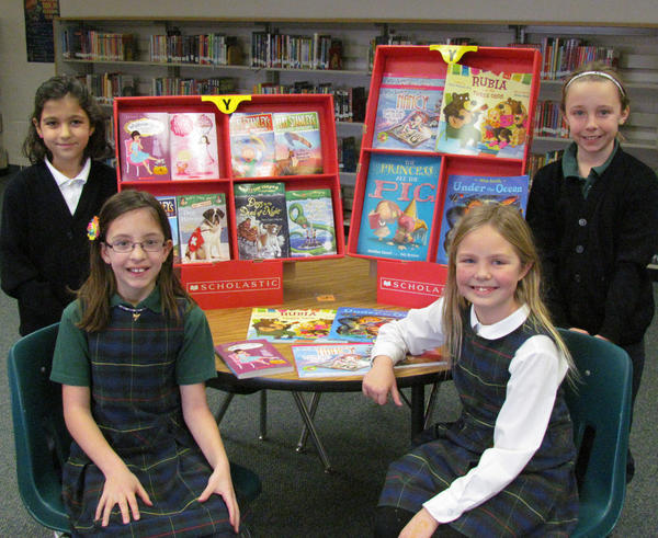 Roncalli third-graders are getting ready for the 2013 book fair. From left: Taryn Emery, Elizabeth Russell, Allie Garofalo and Allie Morgan.