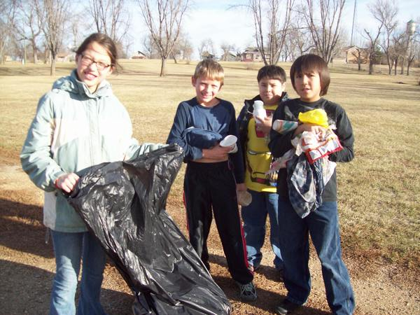 Waubay School third-graders, from left, Sunni O'Riley, Colby Rumpza, Curtis Szoktor and Louis LaCrouix help to clean up the Waubay city park. During December, students in grades three through sixth at the Waubay School learned lessons in citizenship. Students cleaned up the school and city park, used recycled paper to make art and were taught how to care for the community. Their final project was to write letters and create cards for residents of the Strand-Kjorsvig Nursing Home in Roslyn.