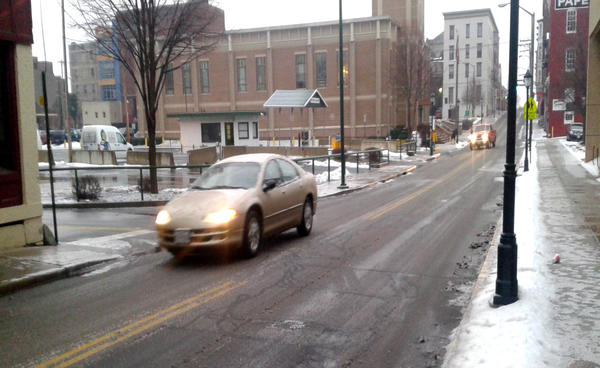 Traffic moves along Antietam Street in Hagerstown on Monday morning as a light freezing rain fell.