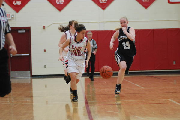 East Jordan's Brianna Newberry (left) had a pair of free throws with nine seconds remaining to lift the Red Devils to a 58-56 win over Grayling Friday.