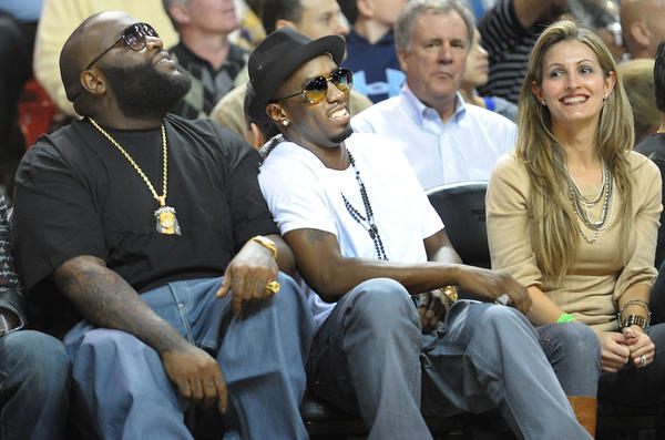 The Miami Heat host the Cleveland Cavaliers at the American Airlines Arena.  Miami rap mogul Rick Ross, at left, shares a laugh with P. Diddy, center, during Monday night's Heat game.
