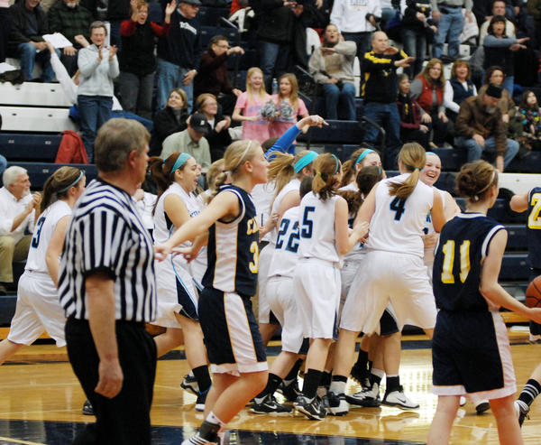 Petoskey senior Kelsey Ance (right) is mobbed by teammates after her game-winning lay up as time expired lifted the Northmen to a 41-40 Big North Conference win over Cadillac at the Petoskey High School gym.