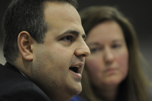 Mark Mattioli speaks at a public hearing on gun control as his wife Cindy looks on.  The Mattiolis lost their son James in the Sandy Hook School massacre.