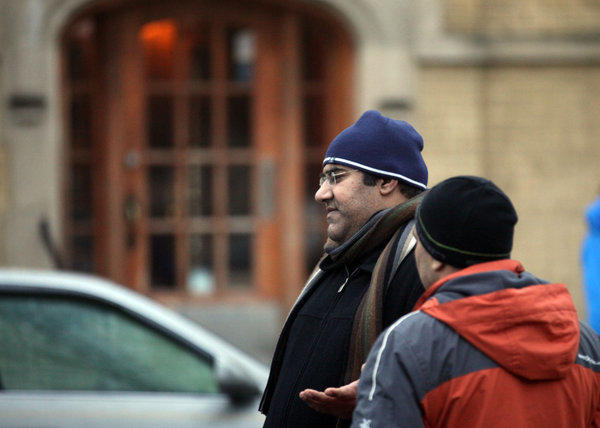 Choudhary Noeman heads to his car after checking on his family at the building on the 2500 block of West North Shore Avenue in West Rogers Park where two women died, apparently from a carbon monoxide leak.