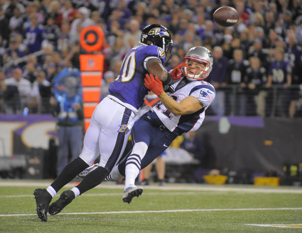 Ravens safety Ed Reed breaks up a pass intended for the Patriots' Julian Edelman during a September game.
