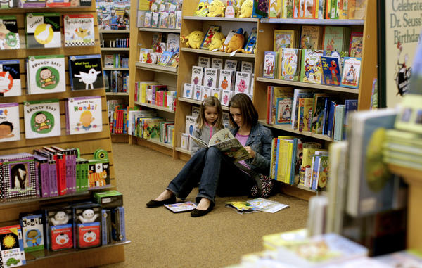 Iva Werner of Los Angeles reads to her daughter Ella, 3, in the children's section at a Barnes & Noble store at the Grove.