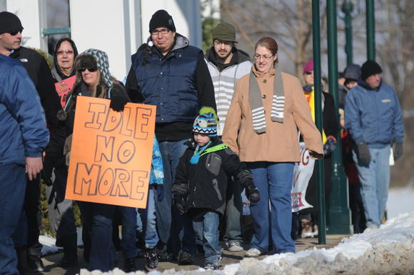 Idle No More supporters demonstrated Saturday afternoon in Petoskey to show solidarity for Canada's First Nations and opposition to loosening environmental protections.