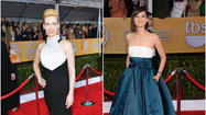 "<span>The biggest trends at the SAG Awards on Sunday night were black, white and dark blue hues, sheer accents, corseted bodices and side-swept </span><a id=""PECLB002898"" class=""taxInlineTagLink"" title=""Veronica Lake"" href=""http://www.latimes.com/topic/entertainment/veronica-lake-PECLB002898.topic"">Veronica Lake</a><span> hair according to T</span>imes fashion critic Booth Moore, who live-blogged the red carpet. <a href=""http://www.latimes.com/entertainment/envelope/fashion/la-et-ar-sag-fashion-20130128,0,1321039.story"" target=""_blank"">[Los Angeles Times]</a>"