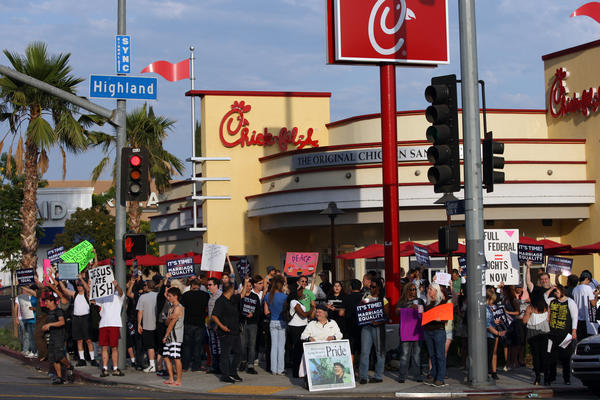 Last year, demonstrators gathered outside a Chick-fil-A in Hollywood to protest comments on gay marriage made by the company's president. Now a gay-rights group says a review of tax forms shows no donations to groups opposing same-sex marriage.
