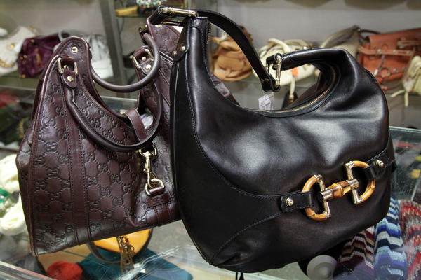 Gucci Pelham Guccissima leather hobo, left, for $690, and Gucci horsebit bamboo hobo handbag for $535, at Couture Upscale Consign in Ft. Lauderdale