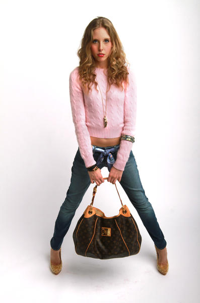 Ralph Lauren Black Label slim fit cable cashmere sweater, Seven jeans, Louboutin Alti Spiked Heels, Louis Vuitton Galleria GM bag, Hermes silk scarf, Roberto Cavalli necklace, Louis Vuitton inclusion bangles, Hermes bracelet. Model Colleen Cooper, stylist Ashley Lipson, clothing provided by Encore Plus.