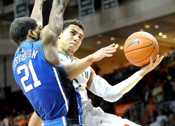 Shane Larkin drives to the basket during Miami's win over Duke. Robert Duyos, Sun Sentinel.