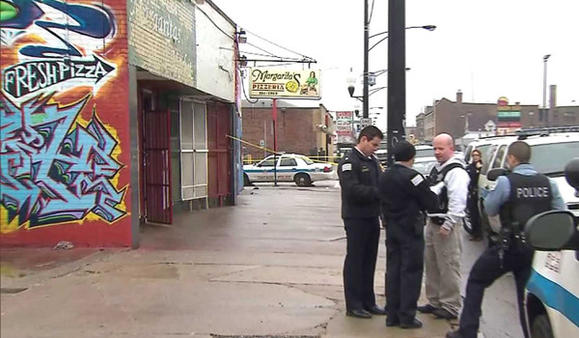 Chicago police at the scene of a double shooting Monday morning. WGN-TV