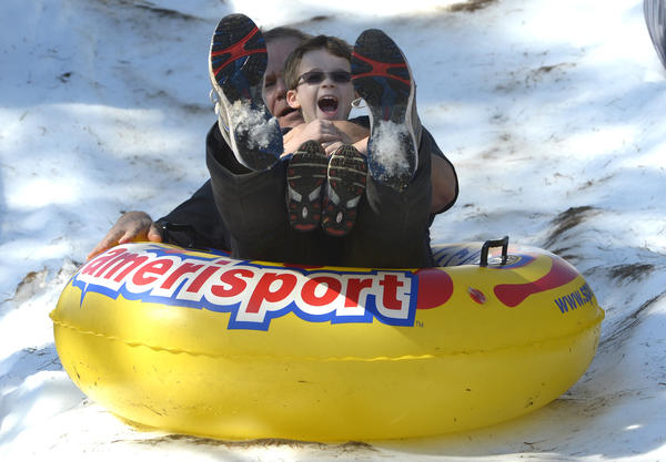 Ted Brozanski, of Windermere, enjoys a snow ride with his grandson Ian Torrente, 5, during The JCC's 4th Annual Winter Festival in Orlando, Fla., Sunday, Jan. 27, 2013.