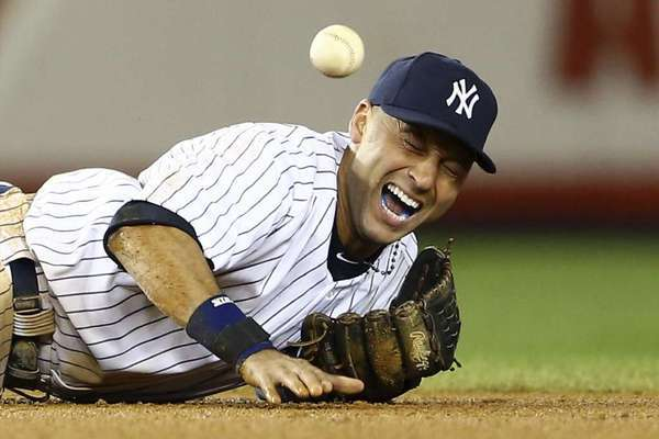 Derek Jeter grimaces in pain after breaking his ankle in Game 1 of the American League Championship Series.