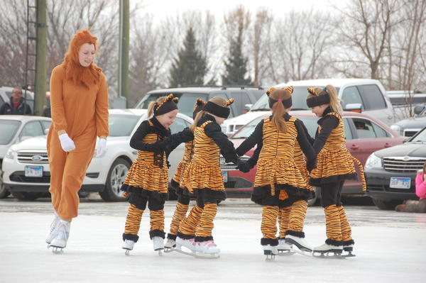 "Breanna Marzahn skates along with kindergartners she coached and taught to perform for the 75th Annual Carnival of Silver Skates in Groton. Marzahn has skated in the carnival since she was eight years old and said the event is the highlight of the year. ""I enjoy skating and it's one of the only sports I do all year,"" she said."