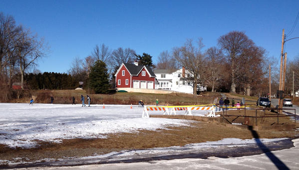 Ice skaters enjoy temperatures in the low 30s Sunday on the pond of Spring Street off of Broad Street in Wethersfield.