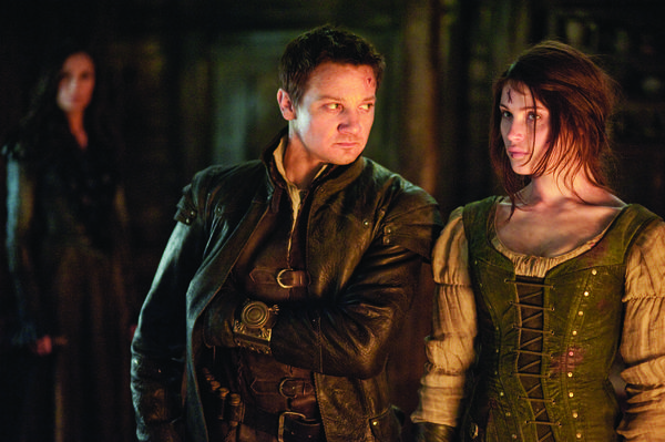 "Famke Janssen as Muriel, Jeremy Renner as Hansel and Gemma Arterton as Gretel in a scene from ""Hansel & Gretel: Witch Hunters"