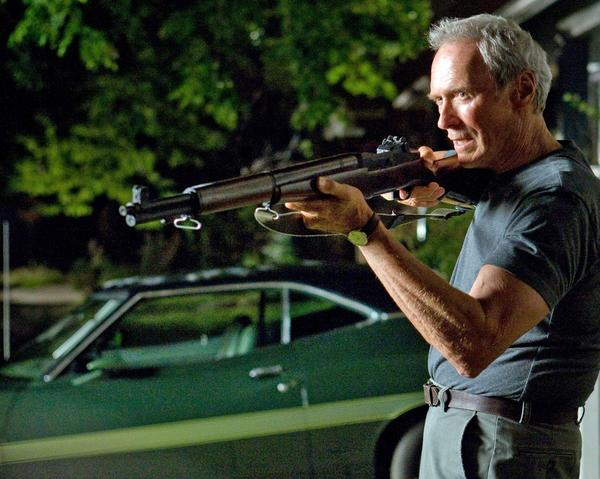 Walt Kowalski (Clint Eastwood) aims an M1 Garand he kept from the Korean War.