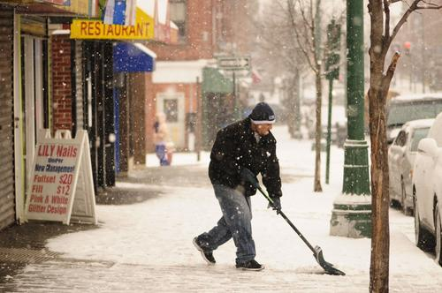 """Helping people,"" says Jose Martinez, 42, of Hartford as he volunteers to shovel snow off the sidewalk on Park Street on Monday afternoon."