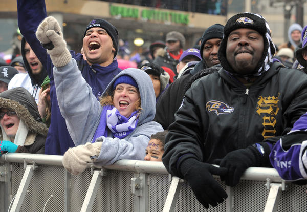 Ravens fans cheer at a rally at the Inner Harbor to see the team before they departed for the Super Bowl in New Orleans.