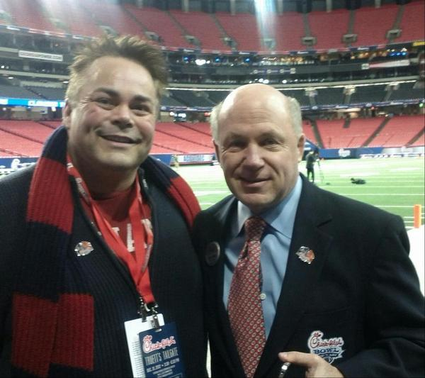 Shane Windmeyer, executive director of Campus Pride, with Chick-fil-A President Dan Cathy at the Chick-fil-A Bowl.