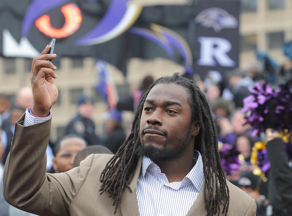 Baltimore Ravens player Dannell Ellerbe turns his phone camera to the crowd.