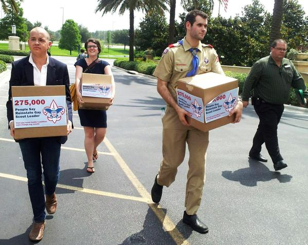 Eagle Scout Zach Wahls (2nd R) delivers cartons of 275,000 petitions to the Boys Scouts of America national board meeting in Orlando in May 2012, calling for an end to anti-gay discriminatory practices. Zach Wahls is an Eagle scout with two lesbian mothers.