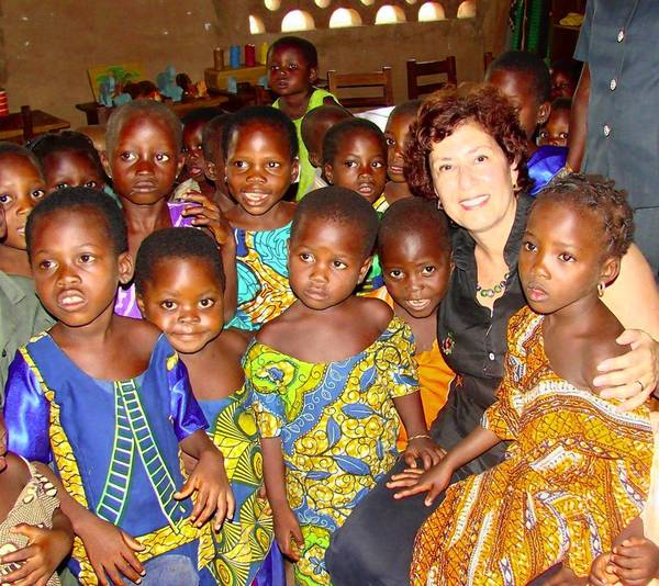 New Trier High School class of 1966 alumni Bonnie Stern Miller is one of 10 NTHS alumni chosen to join the school's third annual Alumni Hall of Honor. Miller is shown here in a 2008 photo with a group of preschool children in Africa.