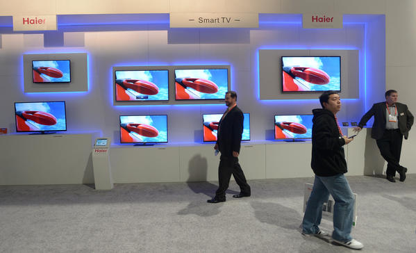 "A new study from KPMG suggests that the majority of Americans now watch TV and access the Web simultaneously. However, consumers say they still prefer to watch video on the TV -- suggesting the next big disruptive technology in the living room may be the Internet-connected ""smart TV,"" like these on display at the recent Consumer Electronics Show."