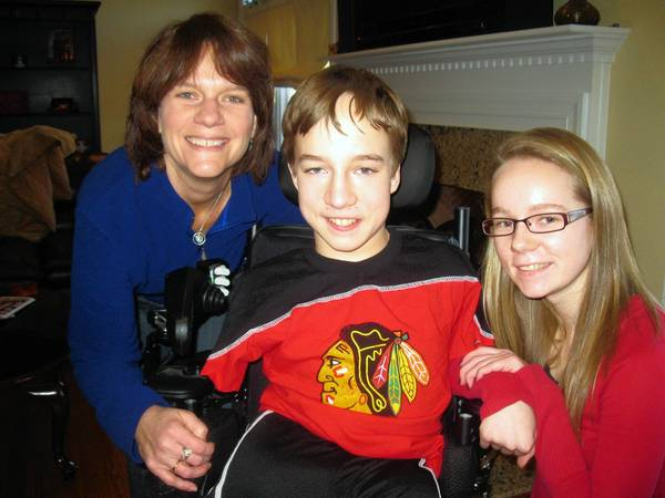 Connor McHugh, 13, of Wheaton, with his mother, Patti, and 16-year-old sister, Killeen. He will be honored at the 25th annual Comcast Sportsnet Sports Awards as Inspiration Athlete.