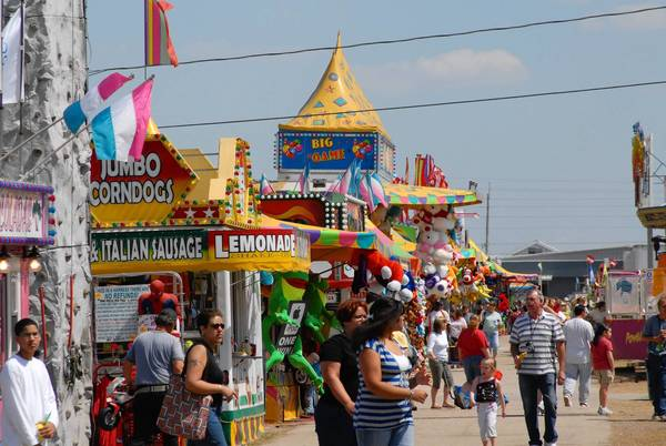 The midway, the music and the strawberry shortcake are the attractions at the Florida Strawberry Festival in Plant City.