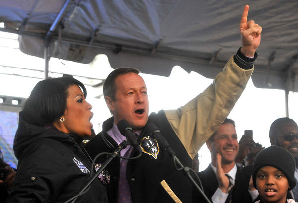Baltimore mayor Stephanie Rawlings-Blake and Maryland governor Martin O'Malley cheer on the Ravens at the Inner Harbor rally.