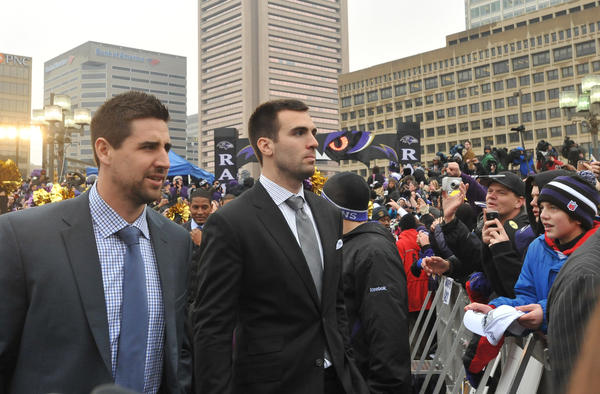 Dennis Pitta and Joe Flacco arrive at the Ravens rally at the Inner Harbor.
