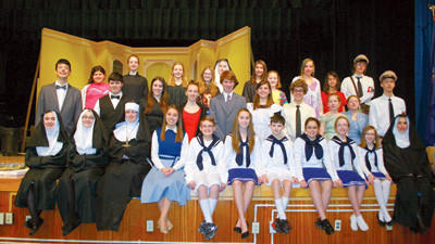 Cast members of Windbers The Sound of Music production sitting tight for a photograph.
