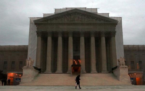 The U.S. Supreme Court, seen here with a realistic-looking drape as restoration work is underway, hears arguments on California's Proposition 8 and the Defense of Marriage Act at the end of March.