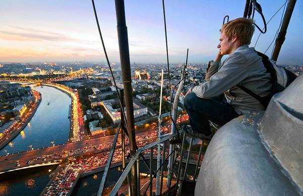 Alexei Nazarov enjoys a sunset view from the roof of a skyscraper in Moscow.