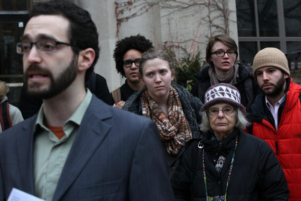 Averill Leslie, left, a graduate student at University of Chicago, and a group consisting mostly of University of Chicago students, held a press conference in front of the administration building today before going inside to object to the treatment of protesters the day before and deliver petitions to the university president about the need for a trauma center.