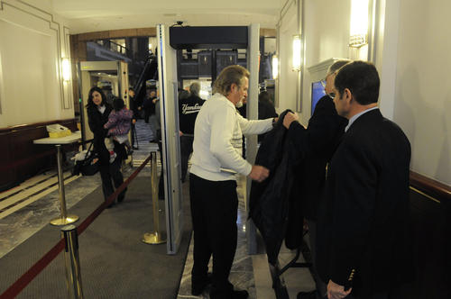 Frank Cornwall of Trumbull goes through a metal detector at the Legislative Office Building Monday as state legislators began hearing testimony on gun control proposals at the Legislative Office Building in Hartford. Checking him in are Capitol security officers, from left, Robert Holmgren and Brian Skehan. Cornwall is the founder of Defense Associates, of Milford, which provides high level firearms training. He said that he had already provided written testimony for the hearing which related that an emotional response to the Newtown tragedy as opposed to a factual one is not the way to deal with the firearms issue. Limiting options for self defense would put more people in jeopardy, he said. At the hearing some Newtown families called for new restrictions on guns and the firearms industry warned of damage to the state's economy.