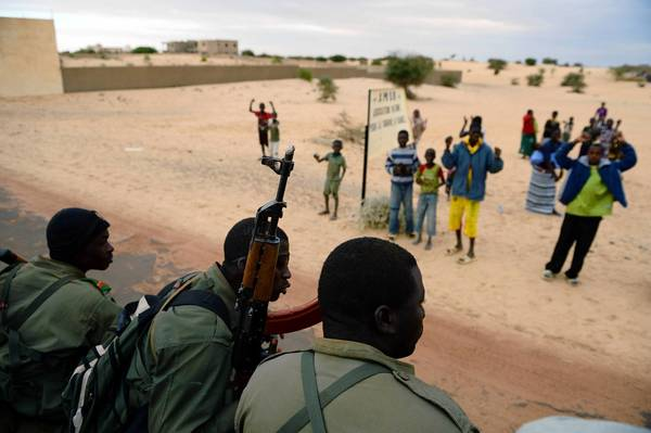 Malian soldiers enter the historic city of Timbuktu, occupied for more than nine months by militants who imposed a harsh form of Islamic law.