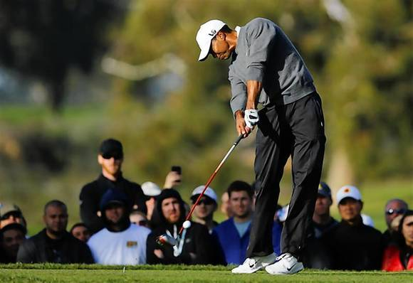 Tiger Woods hits off the 2nd tee during weather delayed fourth round play at the Farmers Insurance Open in San Diego