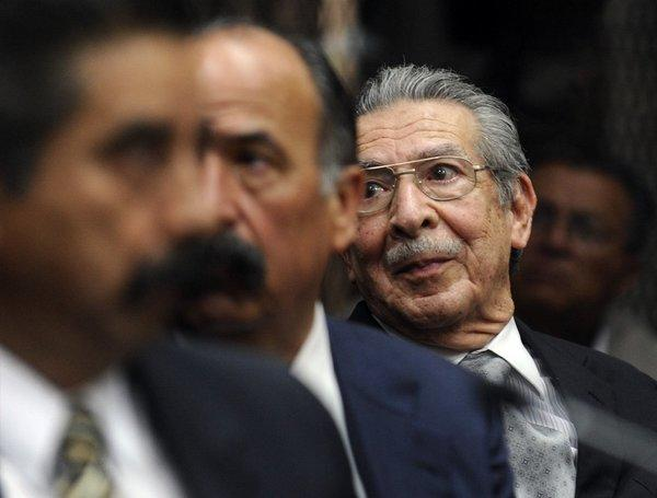 Former Guatemalan leader Efrain Rios Montt, in glasses, appears at a court hearing in Guatemala City. A judge ordered that Rios Montt, 86, face trial on genocide charges.
