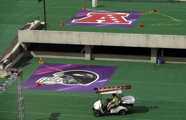 Crews work on fan area outside Superdome in New Orleans.