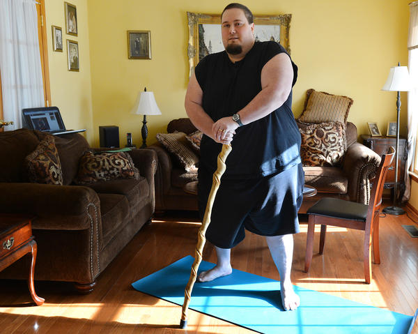 Ben Miller, of Nazareth poses on a yoga mat in his home. At over 400 pounds he is teaming up with three-time WCW Heavyweight Champion of the world, ¿Diamond¿ Dallas Page to come back to his ideal weight using DDP's yoga dvds.
