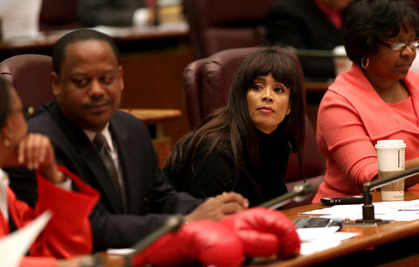 Ald. Sandi Jackson, 7th, sits between Ald. Roderick Sawyer, 6th, and Michelle Harris, 8th, during a Chicago City Council meeting in October 2012.